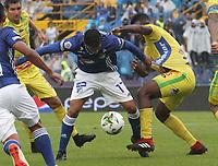 BOGOTÁ - COLOMBIA, 16-02-2019:Cristian Marrugo (Izq.) jugador de Millonarios disputa el balón con Victor Moreno(Der.) jugador del Atlético Huila  durante partido por la fecha 5 de la Liga Águila I 2019 jugado en el estadio Nemesio Camacho El Campín de la ciudad de Bogotá. /Cristian Marrugo (L) player of Millonarios  fights for the ball withVictor Moreno (R) player of Atletico Huila  during the match for the date 5 of the Liga Aguila I 2019 played at the Nemesio Camacho El Campin Stadium in Bogota city. Photo: VizzorImage / Felipe Caicedo / Staff.