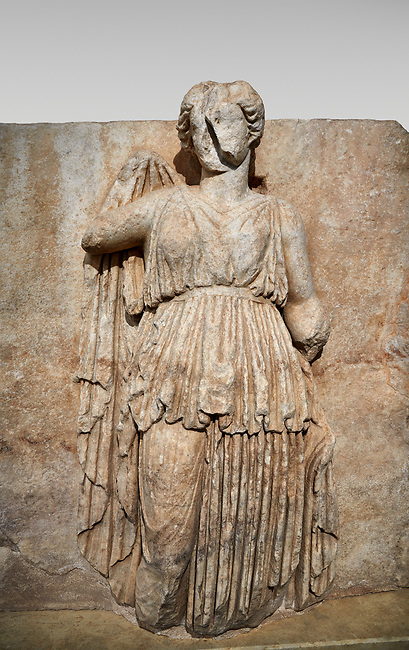 Roman Sebasteion relief sculpture of Ethnos with belted peplos, Aphrodisias Museum, Aphrodisias, Turkey. <br /> <br /> The matronly figure wears a belted classical dress (peplos) and held her long cloak up behind. The square hole above her shoulder with a corresponding hole in the back, was for lifting the finished relief into the ancient building by crane.