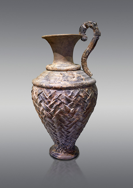 Minoan stone ewer jug  with relief pattern from the  Knossos  Palace 1600-1450 BC, Heraklion Archaeological  Museum, grey background.