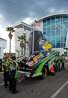 Mar. 9, 2012; Gainesville, FL, USA; NHRA crew members for funny car driver Alexis DeJoria during qualifying for the Gatornationals at Auto Plus Raceway at Gainesville. Mandatory Credit: Mark J. Rebilas-