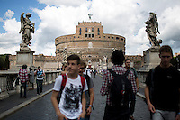 Crowds cross the St. Angelo Bridge in front of Castel Sant'Angelo on Thursday, Sept. 24, 2015, in Rome, Italy. (Photo by James Brosher)