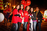 """Walkers participate in the 2010 """"Light the Night"""" event in Rockville, Maryland.  Light the Night is an annual charity walk organized by the Leukemia & Lymphoma Society.  Each year, communities across the US and Canada join together to raise funds, bringing help and hope to people battling blood cancers.  Walkers carry illuminated white, red, and gold balloons as they walk.  White balloons designate survivors, red is for supporters, and gold balloons are in memory of loved ones lost to cancer.  Each walk usually brings 2,000 to 3,000 walkers, and pre-walk festivities are marked by live music and carnival games."""