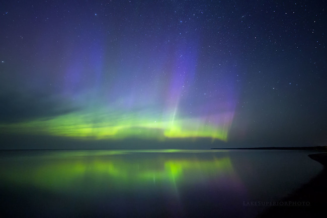 Summer aurora reflections over Lake Superior