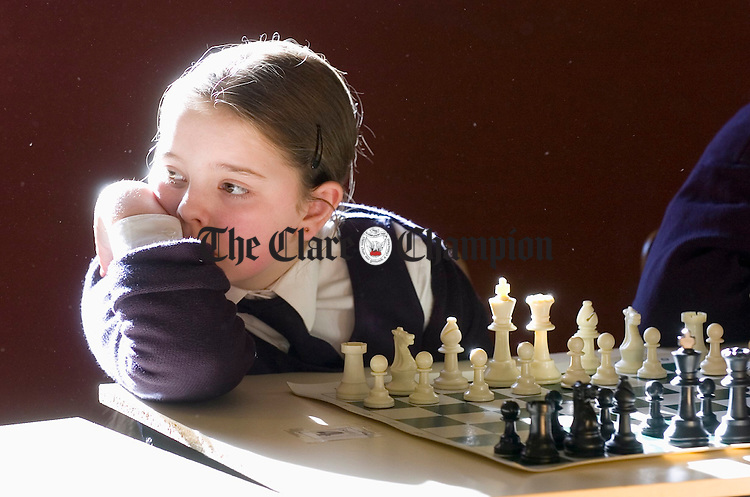 Olivia Quigley of Gaeilscoil Ui Choimin, Kilrush awaits her next competitor at the West Clare Chess Schools tournament in Knockerra Hall. Photograph by John Kelly.