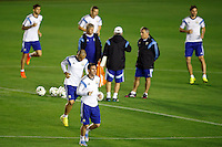 Lionel Messi of Argentina warming up during the training session with Argentina manager Alejandro Sabella behind