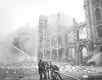 Firemen work after a bombing in London during World War II