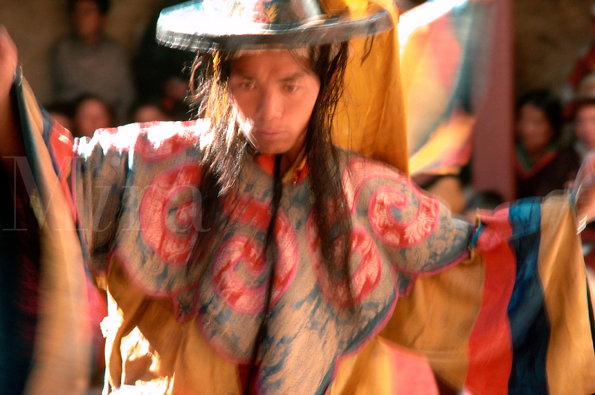 Dancing monk in ceremonial robes at the festival of Mane Rimdu, Thyangboche Monastery, Khumbu region, Nepal.