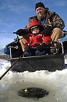 Staff Photo/Mike Ullery.A.J. Monnin of Bradford, Ohio and his three-year-old son Landon spend a Saturday morning ice fishing on Echo Lake in Piqua, Ohio January 31. This was Landon's first ice fishing trip.