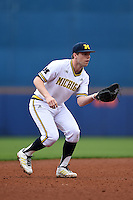 Michigan Wolverines infielder Travis Maezes (9) during the second game of a doubleheader against the Siena Saints on February 27, 2015 at Tradition Field in St. Lucie, Florida.  Michigan defeated Siena 6-0.  (Mike Janes/Four Seam Images)