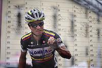 Carlos Quintero (COL/Columbia) signing in<br /> <br /> 2014 Giro d'Italia<br /> stage 18: Belluno - Rifugio Panarotta (Valsugana), 171km