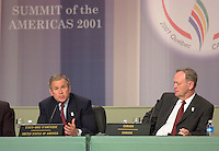 April 22,  2001, Quebec, Quebec, Canada<br /> <br /> Jean Chretien, Canada's Prime Minister (L)  listen while <br /> George W, Bush, United States of Americas President (R)<br />  speak at the closing press conference of the Summit of the Americas , April 22, 2001 in Quebec City, CANADA.<br /> <br /> Both leader agreed to meet before the upcoming G-8 meeting this spring in Alberta, Canada.
