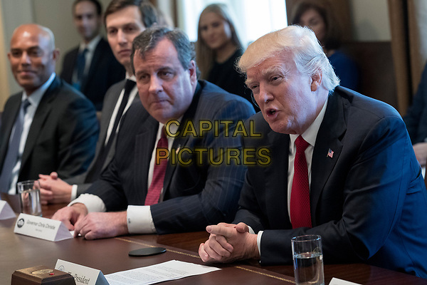 US President Donald J. Trump (R), with New Jersey Governor Chris Christie (2-R), Senior Advisor to President Trump Jared Kushner (2-L) and  former New York Yankee great Mariano Rivera (L), delivers remarks during an opioid and drug abuse listening session in the Roosevelt Room of the White House in Washington, DC, USA, 29 March 2017.<br /> CAP/MPI/CNP/RS<br /> ©RS/CNP/MPI/Capital Pictures