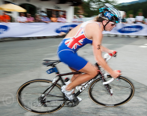 23 JUN 2012 - KITZBUEHEL, AUT - Vicky Holland (GBR) of Great Britain on the bike during the elite women's 2012 World Triathlon Series round in Schwarzsee, Kitzbuehel, Austria .(PHOTO (C) 2012 NIGEL FARROW)