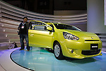 """December 30, 2011, Tokyo, Japan - A press member looks at Mitsubishi Motor Corp's """"Mirage"""" vehicle during the 42nd Tokyo Motor Show. The show opens to the general public from December 3-11. (Photo by Christopher Jue/AFLO)"""