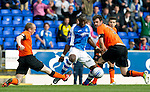 St Johnstone v Dundee United....01.09.12      SPL  .Willo Flood's lunge on Gregory Tade caused a huge rammy between the players.Picture by Graeme Hart..Copyright Perthshire Picture Agency.Tel: 01738 623350  Mobile: 07990 594431