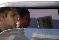 Clodoaldo Carlos Batista de camisa azul a esquerda(co autor) e Amair Feijoli da Cunha o Tato camisa marrom a direita(intermediário), ambos condenados respectivamente a 17 e 18 anos pela execução da missionária americana Dorothy Mae Stang, sairam às 8h deste sábado (9), do Centro de Recuperação do Coqueiro de carro. Eles foram beneficiados pela saída temporária para o dia dos pais. Os dois progrediram de regime em janeiro e fevereiro deste ano, por já terem cumprido o regime fechado, passando para o semi-aberto.Belém, Pará, Brasil.09/08/2008Foto Paulo Santos/Interfoto.