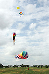 CHAD PILSTER •Hays Daily News<br /> <br /> Isiah Shuler, 9, plays around with some giant kites on Wednesday, June 19, 2013, near the 2500 Block of 13th St. in Hays, Kansas. David Burroughs has giant kites which he bought in Oregon, but likes to fly in Kansas because it is so windy. He regularly passes through Hays twice a year as he moves between Nevada and Virginia.