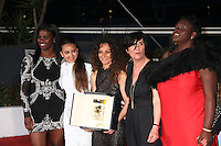 """HOUDA BENYAMINA, WINNER OF THE CAMERA D'OR FOR THE FILM 'DIVINES"""", WITH HER CAST AND CAMERA D'OR JURY PRESIDENT CATHERINE CORSINI - PHOTOCALL OF THE WINNERS AT THE 69TH FESTIVAL OF CANNES 2016"""