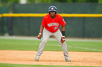 Juan Santana (27) of the Greeneville Astros takes his lead off of first base against the Burlington Royals at Burlington Athletic Park on July 1, 2013 in Burlington, North Carolina.  The Astros defeated the Royals 7-0 in Game One of a doubleheader.  (Brian Westerholt/Four Seam Images)