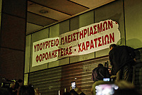 "Protesters from the communist-affiliated trade union PAME place a banner which reads ""Ministry of foreclosures and tax thieves"" at the entrance of the Finance Ministry during a demonstration against property foreclosure auctions in Athens, Greece. Wednesday 21 February, 2018."