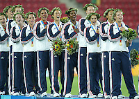 26 August 2004:  USA team with gold medal during the national anthem after defeating Brazil, 2-1 in overtime at Karaiskakis Stadium in Athens, Greece.  Credit: Michael Pimentel / ISI.