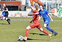 forward Hanne Merkelbach (25) of KRC Genk and Magali Dinon (6) of Woluwe pictured during a female soccer game between FC Femina White Star Woluwe and KRC Genk on the 17 th matchday of the 2020 - 2021 season of Belgian Scooore Womens Super League , Saturday 20 th of March 2021  in Woluwe , Belgium . PHOTO SPORTPIX.BE | SPP | JILL DELSAUX