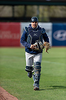 Cedar Rapids Kernels catcher David Banuelos (15) jogs onto the field to warm up a pitcher between innings of a Midwest League game against the Kane County Cougars at Northwestern Medicine Field on April 28, 2019 in Geneva, Illinois. Kane County defeated Cedar Rapids 3-2 in game one of a doubleheader. (Zachary Lucy/Four Seam Images)
