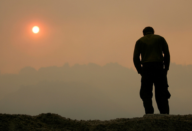 A firefighter watches a wild fire burn uncontrolled in Big Sur, Calif., Thursday, July 3, 2008. The blaze near Big Sur was one of more than 1,700 wildfires, most ignited by lightning, that have scorched more than 770 square miles and destroyed 64 structures across northern and central California since June 20, according to state officials. (AP Photo/Paul Sakuma)