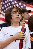 A USA fan during the playing of the National Anthem. The men's national teams of the United States and Argentina played to a 0-0 tie during an international friendly at Giants Stadium in East Rutherford, NJ, on June 8, 2008.