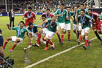 Mexico players rush at the  CONCACAF trophy... Mexico defeated Honduras 2-1 after extra time to win the CONCACAF Olympic qualifying trophy at LIVESTRONG Sporting Park, Kansas City, Kansas.