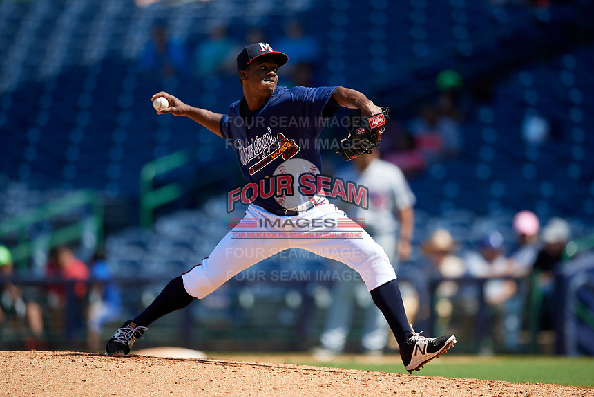 Mississippi Braves relief pitcher Claudio Custodio (14) during a Southern League game against the Jacksonville Jumbo Shrimp on May 5, 2019 at Trustmark Park in Pearl, Mississippi.  Mississippi defeated Jacksonville 1-0 in ten innings.  (Mike Janes/Four Seam Images)