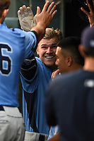 Charlotte Stone Crabs first baseman Jake Bauers (23) congratulated by teammates after a home run during a game against the Bradenton Marauders on April 20, 2015 at McKechnie Field in Bradenton, Florida.  Charlotte defeated Bradenton 6-2.  (Mike Janes/Four Seam Images)