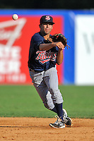 Elizabethton Twins shortstop Carlos Avila #25 fields and throws to first during a game against the Kingsport Mets at Hunter Wright Stadium on June 29, 2013 in Kingsport, Tennessee. The Mets won the game 5-4. (Tony Farlow/Four Seam Images)