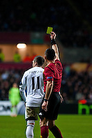 Swansea, UK. Thursday 20 February 2014<br /> Pictured: Pablo Hernandez receives a yellow card<br /> Re: UEFA Europa League, Swansea City FC v SSC Napoli at the Liberty Stadium, south Wales, UK