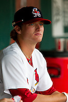 Shelby Miller (26) of the Springfield Cardinals sits in the dugout during a game against the Northwest Arkansas Naturals at Hammons Field on July 31, 2011 in Springfield, Missouri. Northwest Arkansas defeated Springfield 9-1. (David Welker / Four Seam Images).