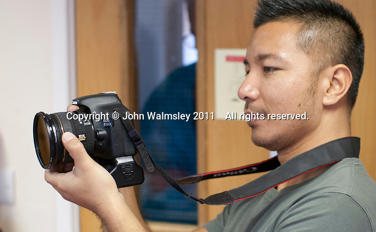 Taking photos at the reunion for Summerhill School's 90th birthday celebrations.