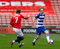 2nd April 2021, Oakwell Stadium, Barnsley, Yorkshire, England; English Football League Championship Football, Barnsley FC versus Reading; Lewis Gibson of Reading plays a pass beyond Callum Brittain of Barnsley