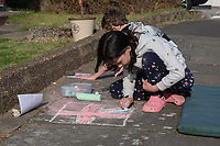 Welling and Sidcup, Kent, England.Children draw chalk flags to commemorate the 75th Anniversary of Victory in Europe (VE) Day during lockdown due to the Coronavirus sweeping the country. Photo by Alan Stanford / PRiME Media Images