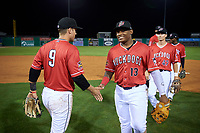 Batavia Muckdogs Albert Guaimaro (13) shakes hands with Andrew Turner (9) after a NY-Penn League game against the Lowell Spinners on July 11, 2019 at Dwyer Stadium in Batavia, New York.  Batavia defeated Lowell 5-2.  (Mike Janes/Four Seam Images)