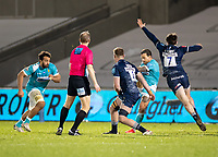 8th January 2021; AJ Bell Stadium, Salford, Lancashire, England; English Premiership Rugby, Sale Sharks versus Worcester Warriors; Francois Hougaard of Worcester Warriors plays a high ball which Tom Curry of Sale Sharks tries to charge down