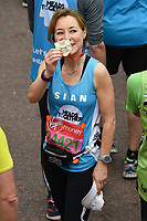 Sian Williams<br /> carried away by St John's Ambulance at the finish line on The Mall at the 2017 London Marathon, London. <br /> <br /> <br /> ©Ash Knotek  D3254  23/04/2017