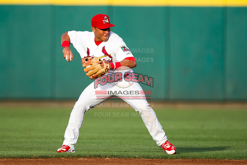 Kolten Wong (4) of the Springfield Cardinals throws to first base during a game against the Arkansas Travelers at Hammons Field on June 12, 2012 in Springfield, Missouri. (David Welker/Four Seam Images)