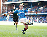 Robbie Crawford does his best to keep the ball in play as Rangers attack once again