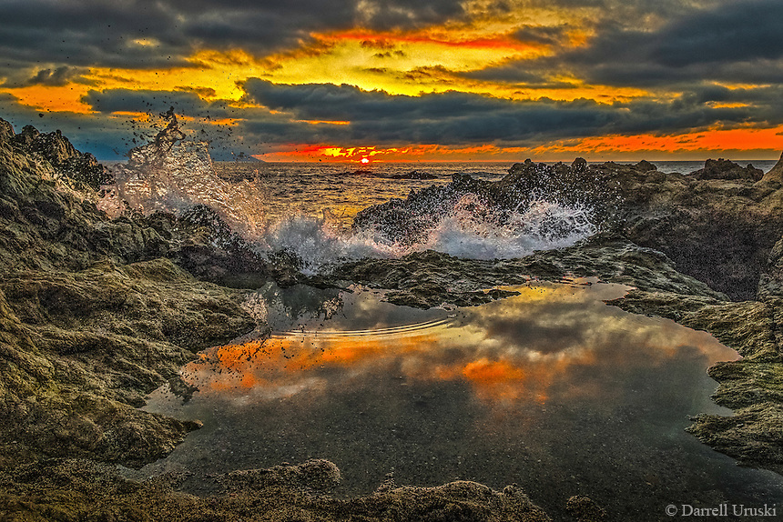 Fine Art Scenic of a ocean wave crashing into a still pond of water along the Pacific ocean in Mexico.