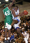 WATERBURY, CT. 06 January 2006-010606SV10--#32 Damian Saunders of Crossby goes up for a shot under the hoop as #42 Tyrone Coleman of Wilby defends during NVL basketball action in Waterbury Friday. <br /> (please use credit, not archive)<br /> Steven Valenti Republican-American