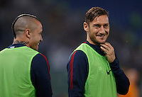 Calcio, Serie A: Roma vs Inter. Roma, stadio Olimpico, 2 ottobre 2016.<br /> Roma's Radja Nainggolan, left, and Francesco Totti smile as they warm up during the Italian Serie A football match between Roma and FC Inter at Rome's Olympic stadium, 2 October 2016.<br /> UPDATE IMAGES PRESS/Isabella Bonotto