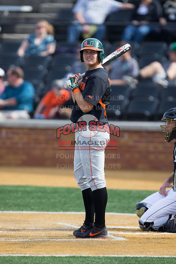David Thompson (8) of the Miami Hurricanes checks with his third base coach during the game against the Wake Forest Demon Deacons at Wake Forest Baseball Park on March 21, 2015 in Winston-Salem, North Carolina.  The Hurricanes defeated the Demon Deacons 12-7.  (Brian Westerholt/Four Seam Images)