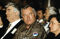 """Yougoslavia. Bosnia. Serbian republic. Bijelina. Radovan Karadzic (L). Ratko Mladic (R) and his wife. Celebration for """"Vidovdan"""" day. Each year on the 28th of June, the serbs celebrate the day of the army. Religious service in the orthodox church. Radovan Karadzic was arrested in Belgrade on 21 July 2008. He was extradited to the Netherlands, and is currently in The Hague, in the custody of the International Criminal Tribunal for the former Yugoslavia. General Ratko Mladic is on the list of the International Criminal Tribunal for the former Yugoslavia (ICTY), based in The Hague in the Nederlands, as a most wanted man for war crimes. © 1995 Didier Ruef"""