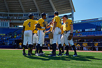 Michigan Wolverines players, including Ako Thomas (4), Christan Bullock (5), Jonathan Engelmann (2), Miles Lewis (3), get ready to take the field before a game against Army West Point on February 17, 2018 at Tradition Field in St. Lucie, Florida.  Army defeated Michigan 4-3.  (Mike Janes/Four Seam Images)