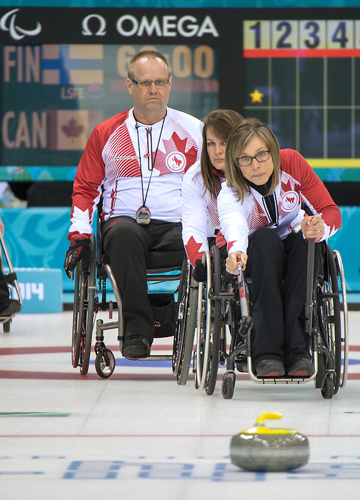 Dennis Thiessen, Ina Forrest and Sonja Gaudet, Sochi 2014 - Wheelchair Curling // Curling en fauteuil roulant.<br /> Canada takes on Finland in Wheelchair Curling // Le Canada affronte la Finlande au curling en fauteuil roulant. 13/03/2014.
